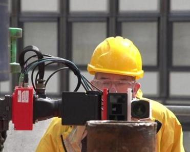 Shell TechWorks engineer Leland Smith sets up a new sensor system on a test rig in Rijswijk, Netherlands.